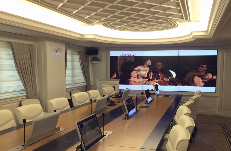motorised monitors for videoconference rooms